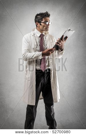 handsome doctor reading documents