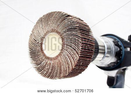 Closeup Of Sanding Flap Wheel On Electric Drilling Machine