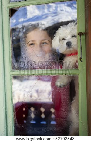 Winter holidays, ski holidays, apres ski - child with puppy  in a room apartment