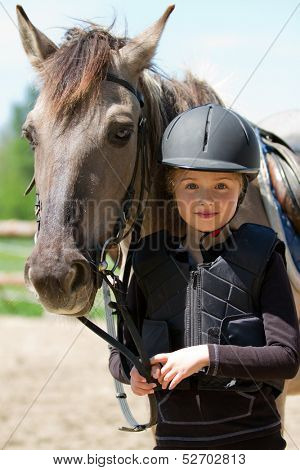 Horse riding, portrait of lovely equestrian with horse