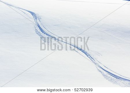 Skiing, snow - freeride tracks on powder snow