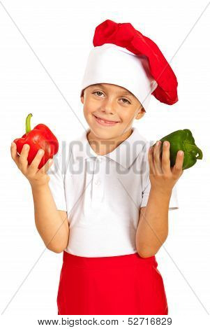 Cheerful Boy Holding Bell Peppers
