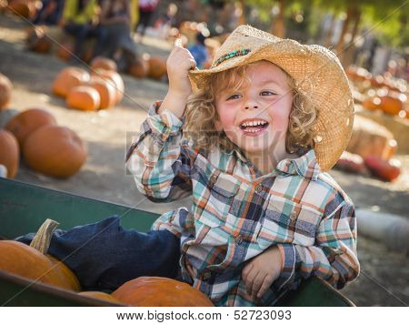 Adorable Little Boy Wearing Cowboy Hat at Pumpkin Patch Farm.