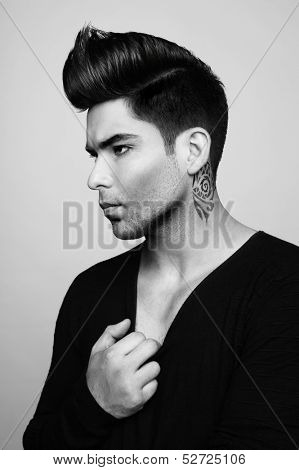 Portrait of handsome man with stylish haircut