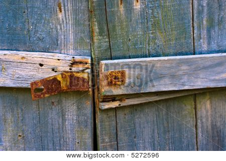 Colorful Weathered Old Wooden Gate And Latch
