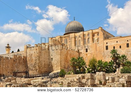 Dome of Al-Aqsa Mosque surrounded by walls and ancient ruins in Old City of Jerusalem, Israel.