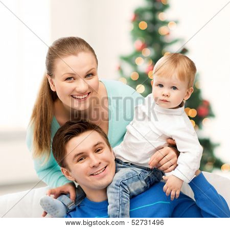 christmas, x-mas, winter, family, people, happiness concept - happy parents playing with adorable baby