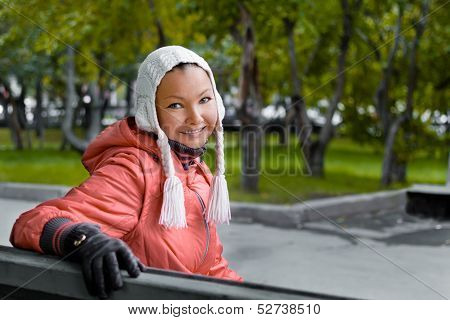 Autumn portrait of yound woman in red jacket