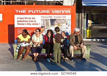 Poster Project Future Vienna Stands Behind A Bench With People.