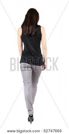 back view of walking  woman in gray trousers. beautiful brunette girl in motion.  backside view of person.  Rear view people collection. Isolated over white background.