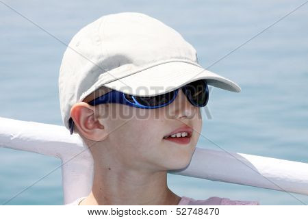 child with cancer applying sun screen