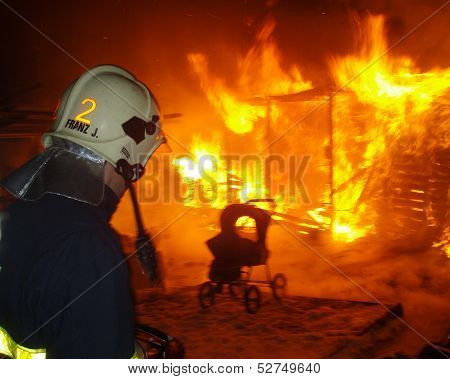 firefighter and burning house