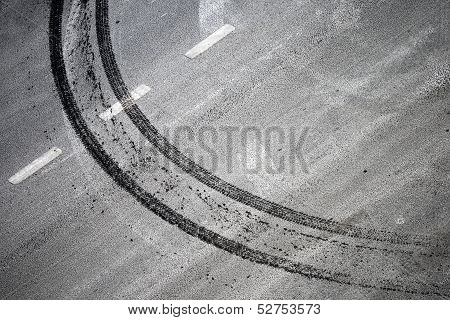 Abstract Road Background With Crossing Of Road Marking And Tires Track