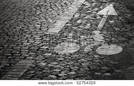Bicycle Lane Marking On The Old Block Pavement