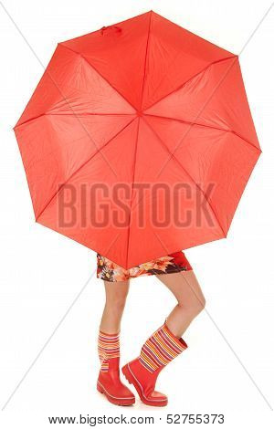 Woman Legs And Boots Show Under Umbrella