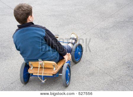 Boy In Cart