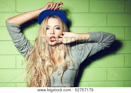 Young Woman  In Wall Background