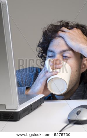 Tired Man At Computer Desk