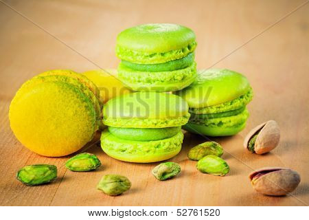 pistachio and lemon macaroons on wooden table