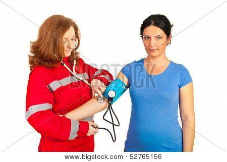 Paramedic Checking Blood Pressure