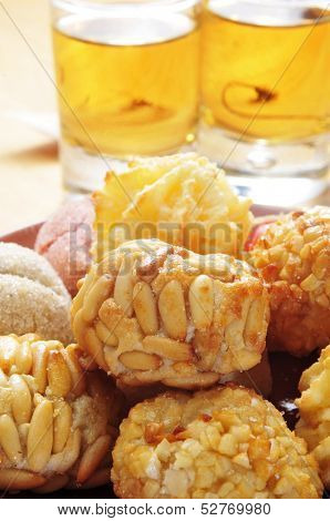some panellets and some glasses with sweet wine, typical snack in All Saints Day in Catalonia, Spain