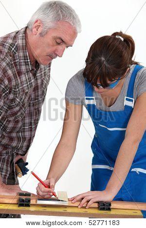 A carpenter and his apprentice.
