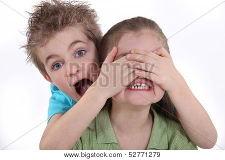 Children playing peek-a-boo