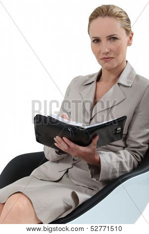Woman sat taking notes