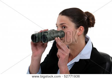 Businesswoman with a pair of binoculars