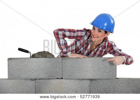 portrait of young female bricklayer