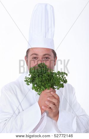 Chef smelling green herb