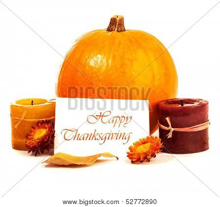 Traditional Thanksgiving day decoration isolated on white background, yellow gourd with candles and greeting card, autumn harvest holiday