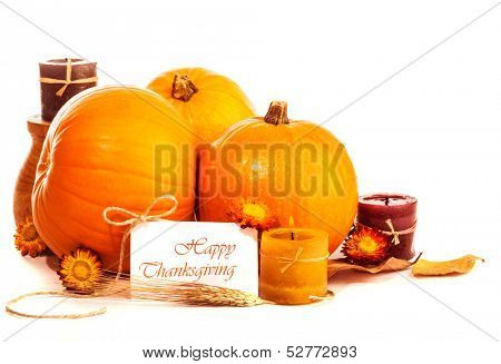 Thanksgiving day still life on isolated on white background, happy holiday, ripe orange gourds with candle and dry flowers, greeting card, harvest season concept
