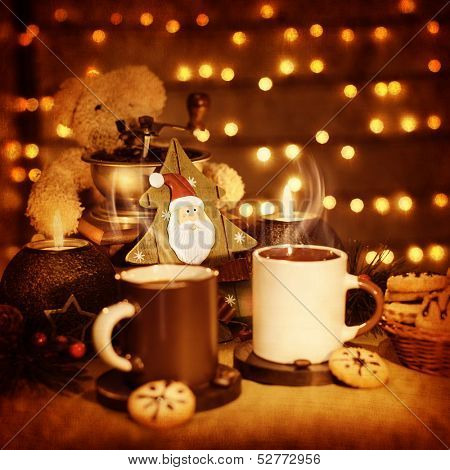 Image of beautiful Christmastime still life, traditional gingerbread with coffee cups on the table, teddy bear with decorative wooden Christmas tree adorn holiday dessert, New Year greeting card