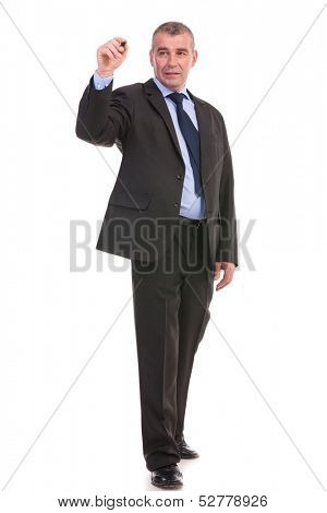 full length picture of a business man writing something on an imaginary screen. on a white background