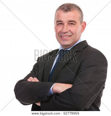 closeup of a business man smiling for the camera while holding his hands crossed. on a white background