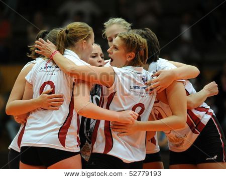 KAPOSVAR, HUNGARY - SEPTEMBER 20: Kaposvar players celebrate at the Hungarian I. League volleyball game Kaposvar (white) vs Ujpest (purple), September 20, 2013 in Kaposvar, Hungary.