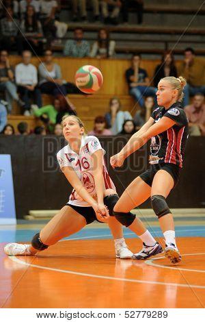 KAPOSVAR, HUNGARY - SEPTEMBER 20: Rebeka Rak (white 16) in action at the Hungarian I. League volleyball game Kaposvar (white) vs Ujpest (purple), September 20, 2013 in Kaposvar, Hungary.