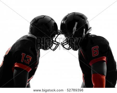 two american football players face to face in silhouette shadow on white background