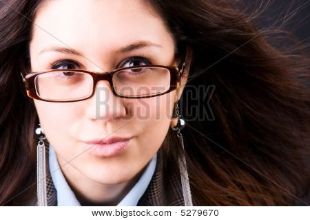 Young Brunette Woman With Fluttering Hair Portrait