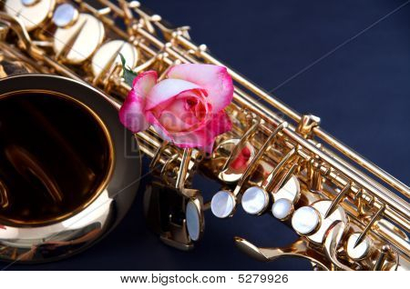 Gold Saxophone With Pink Rose On Blue