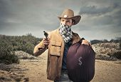 stock photo of swag  - bandit with gun and big sack of money - JPG