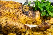 foto of barbary duck  - Stuffed roast duck with sauerkraut in a pan - JPG