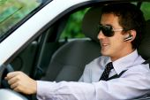 image of hands-free  - Businessman driving in the car with hands - JPG