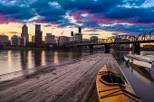 stock photo of portland oregon  - Portland Oregon Panorama. Sunset scene with dramatic sky and light reflections on the Willamette River.