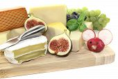 stock photo of grated radish  - fresh selection of cheese with knife grapes and figs - JPG