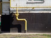 pic of pipefitter  - a gas tube leading to a house - JPG