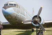 foto of raunchy  - Old, superannuated aircraft stay still on grass