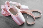 image of pink shoes  - new pink ballet pointe shoes on vintage wooden background - JPG