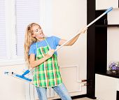 Funny woman with mop. Female cleaning home